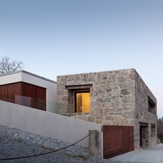 FCC Arquitectura slots family home within stone walls of dilapidated farmhouse