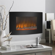 "Where there's No Smoke…. ….there's still fire with this electric wall-mounted fireplace! Energy efficient, no emissions, and it can be installed almost anywhere. Simply hang it up, plug it in and enjoy. Includes 3D flame technology, dual heat settings (750W and 1500W), full function remote control, elegant black glass front and dancing flame effect. Overall dimensions: 35""(w) x 22""(h) x 6""(d). Makes a Great Christmas Gift! 100% BRAND NEW AND HIGH QUALITY!! Safe and Secure Checkout"