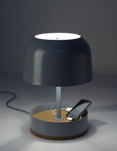 A lamp and charging station for portable devices