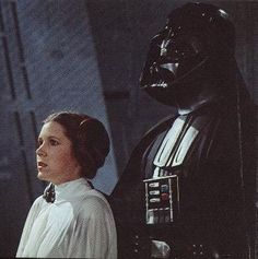 Carrie Fisher as Princess Leia and David Prowse Darth Vader.