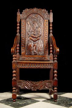 Antique old Jacobean Arm chair in carved oak.