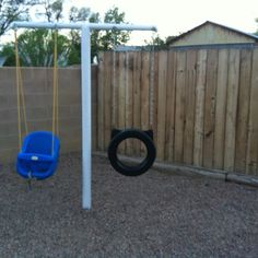 Old clothesline re-purposed as a swing set for the kids