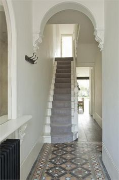Elegant neutral entrance hall with bespoke stone staircase. .  #homeinteriorsleicester