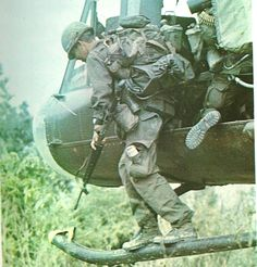 Stepping off a Huey rail. ~ Vietnam War