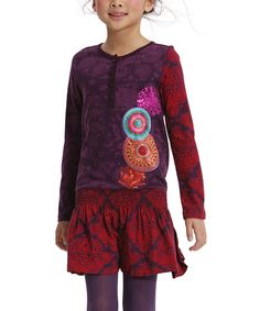Rocking a colorful mix of prints and a bright geometric graphic, this tunic energizes any wardrobe. The ruched waistband, flared fit and soft cotton construction prove a little maven doesn't have to sacrifice style for comfort.