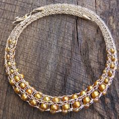 Gold with brown pearl
