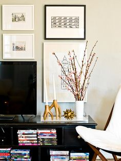 Tall objects. Tall objects are a home stylist's secret weapon. They can draw attention away from something unsightly (like the TV) and fill in visual gaps, like that space between your bedside table and the top of your headboard. Try a tall, narrow vase filled with blooming branches, a potted topiary or tall candlesticks.