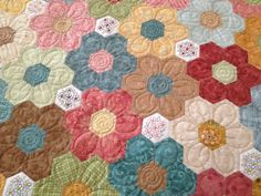 I have picked up my Hexagon guilt from Belinda    and couldn't wait to show you all.....   She has done an amazing job and I am just a tad...