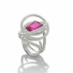 Rubellite tourmaline (9.19cts) and diamond ring by Margherita Burgener. The ring is set with an intense step-cut rubellite tourmaline and pavé set white diamonds.