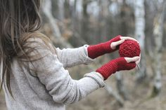 the girl with a red hand likes a forest very much