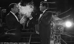 Smokin' hot: This intimate shot captures Sinatra and Martin as they unwind in the NBC studios in 1962