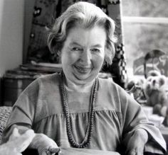 Rosemay Sutcliff, late in her life (1920 − 1992), sat at her desk in her study in Sussex.