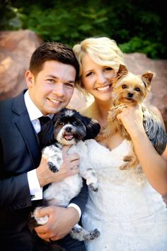 Looking very happy on their big day with their dogs with them for moral support