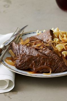 A few hours in the slow cooker and this beef dish will be melt-in-your-mouth delicious by the time you're ready to eat it. #foodandwine #comfortfood #comfortfoodrecipes