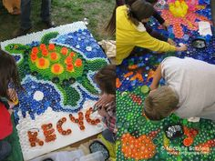 © Michelle Stitzlein | Bottle cap art - What a great way to reuse old bottle tops.