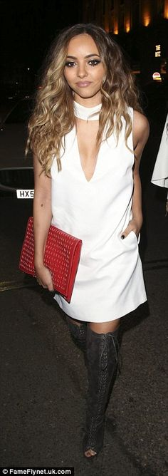Strutting it: Jade, 22, made her way into the club in a white shift dress with feature a n...