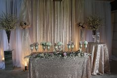 Champagne and sparkle wedding sweetheart table from Village Vines Wedding and Event Decor www.villagevinesflorists.com