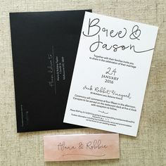 Black and white letterpress invitation, black envelopes with white ink printing and peach watercolour belly bands