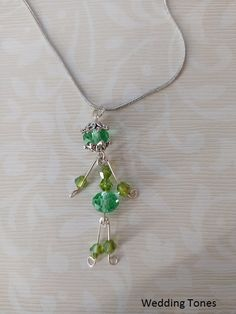 Handmade necklace with miniature person pendant with green crystals Green Necklace, Crystal Necklace, Pendant Necklace, Diy Jewelry, Jewellery, Handmade Copper, Gold Hair, Puppet, Handmade Necklaces