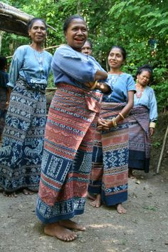 Proud weavers: Members of the Threads of Life weaving group from Bliran Sina in Maumere, Flores show off their work. (Ph...