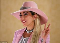 Glamour girl: Gaga's image for her latest studio album contrasts with her more wild looks ...