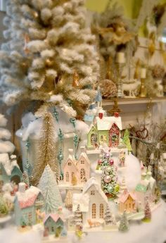 PUTZ VILLAGE SET UP WITH FEATHER CHRISTMAS TREES DECORATED WITH ANTIQUE AND
