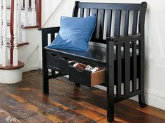 A multipurpose bench is the key to a clean entryway, perfect for storing items in the drawers beneath the seat that you can adorn with decorative pillows.