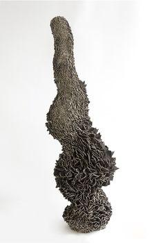 Formed Shards, Zemer Peled. Made of broken ceramics.  http://zemerpeled.com/work/#/formed-shards-1/