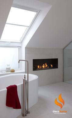 Beautiful Scandinavian bathroom with a Decoflame Montreal bioethanol fireplace installed.