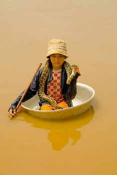 Lake Tonle Sap, Cambodia.  I actually saw her!  She will come close to your boat and will let you hold onto her snake for a picture and tip.