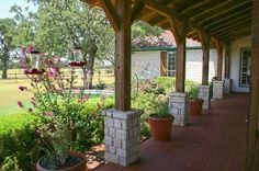 Austin stone porch with wood beams
