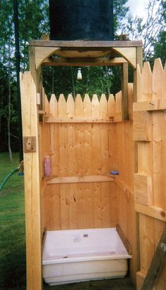 The water for this homemade outdoor shower is heated by the sun, saving you money and energy. You can build it with a bit of lumber, a used 50-gallon drum, and a few plumbing parts from the hardware store.data-pin-do=