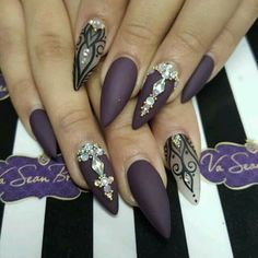 Beautiful matte plum stiletto nails with diamonds
