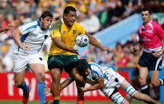 Austràlia 65-3 Uruguai #RWC2015 #AUS vs #URU #StrongerAsOne vs #VamosTeros / Uruguay's Matias Beer dives in to tackle Australia's Scott Sio as he catches the ball