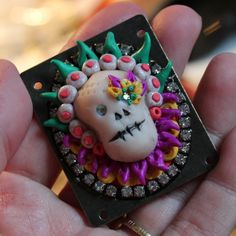 So, it's pretty early (or, conversely, late) to be making Calaveras (sugar skulls) for DIa-de-los-Muertas (Day of the Dead), but this is such a great tutorial.     Bonus: she uses glow-in-the-dark clay!   Extra Bonus: Since these use small bits of all colors except the skull base color, they would be a great way to use up scrap clay, too.   Polymer Clay Sugar Skull Pendant