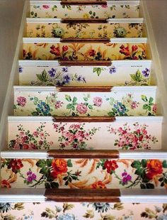 charming cottage style stairway -- cute way to use up wallpaper remnants (*We could do something like this for the stairs to the basement and use a light in the middle of each step (where you see the wood) to light the way_LL)