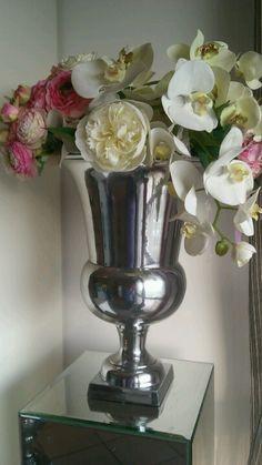 Tuscan modern aluminium urn on mirrored pillar