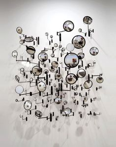 assorted mirrors, pinned by Ton van der Veer Analyze this booth display. What makes it work....the reflections, the dynamic arrangement, the innovative use of small mirrors. The mirrors look like bubbles giving it an effervescent quallity.