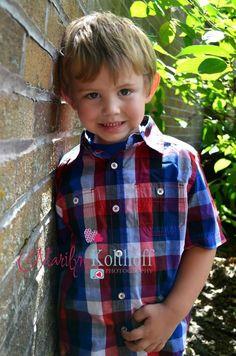 Cute little boy photo idea. Outdoor. Brick wall