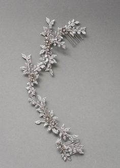 Inspired by the beauty and chaos of overgrown vines, the Anais crystal bridal hair piece perfectly frames an updo, loose curls or something in between.