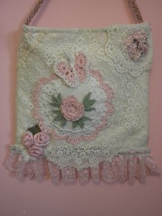 This shabby chic wedding dance bag is covered with vintage doilies, crocheted doily, with a rose and butterfly in soft petal pink with mint green
