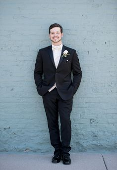 Classic groom style with black tux and ivory bow tie.