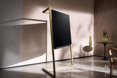 Designed by London-based Bodo Sperlein, the Loewe Bild 9 TV combines British design with German engineering. Influenced partly by Art Deco, the TV sits inside one of three metal frames - there's one for a table, a wall, and a...