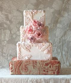 Feathers tapestry and lace cake