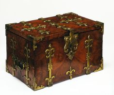 """1680-1700 English Strong box at the Victoria and Albert Museum, London - From the curators' comments: """"Kingwood, a form of rosewood from Central and South America, was much admired for its natural grain patterns. It was used as decorative veneer, even on something as utilitarian as a strong box....The nobility used these portable strong boxes when travelling between their various properties, often in times of uncertainty and political upheaval."""""""