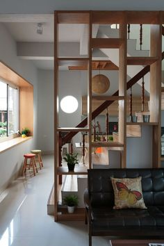 Wood Wall Planter Shelf As Room Divider Renovated Living Design Beside Staircase With White Ceramic Floor Tiles Ideas