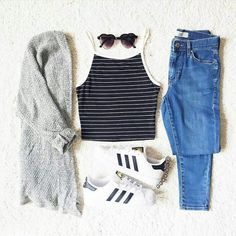 Fall outfit // casual // adidas superstar // halter top black and white // high waisted blue denim jeans // jegging // salt and pepper cardigan // heart sunglasses