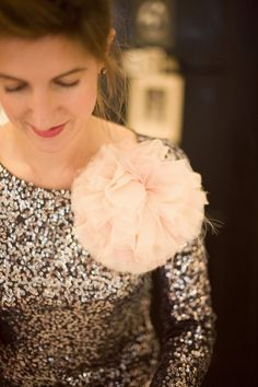 Ummm, this is kind of the best look ever...sparkly top with huge flower pin? done and done.