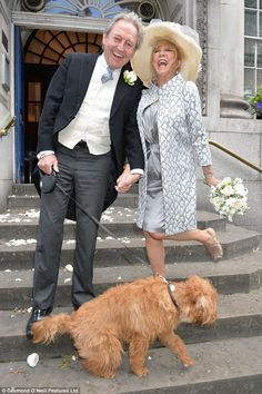 Pattie, photographed with Rod and their dog Freddie, was famously married to both George H...