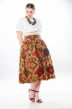 JIBRI High Waist Tribal Flare Skirt      * Chic side pockets     * Back zipper     * Fabrication: Linen     * Sizing: True to Size  (View Size Chart)     * Handmade in Atlanta, GA  Style Notes: Perfect for all seasons. Pair with tights in the fall or  sandals in the spring or summer. Perfect with a fitted tee or a more glam  blouse (as pictured). Effortlessly stylish and flattering for most body  types. Midi Legth pictured  Sizing Tip: Order according to waist measurement. No stretch.